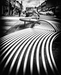 From one end to the other. (Mister G.C.) Tags: blackandwhite bw image streetshot streetphotography photograph monochrome urban town city bench seat outdoors man male guy sitting gritty lowpov lowpointofview leadinglines zonefocus zonefocusing snapfocus ricoh ricohgr pointshoot mistergc schwarzweiss strassenfotografie scotland britain greatbritain gb british uk unitedkingdom europe