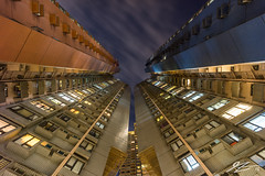 Rise Ever Higher #1 (Tim van Zundert) Tags: hong kong island sheung wan china architecture buildings flats towers night evening long exposure sky lights sony a7r voigtlander 21mm ultron