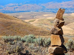 Rock Stack (starmist1) Tags: rockstack badgermountain wheatfields badlands hills slopes flowers weeds mountains river city draw canyon scenic landscape powerlines barbwire badgermountainroad