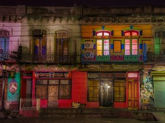 Facades of a neighborhood at night (karinavera) Tags: travel nikond5300 night laboca street colors argentina buenosaires wallart urbanexploration longexposure facades city colorful cityscape downtown emblematicplaces noche exploration urban view calle caba