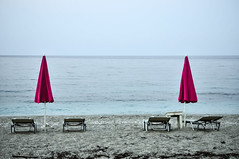 End of season (lorenzog.) Tags: endofseason agiosioannis aghiosioannis pilion pilio pelion pelio beach beachlife beachumbrella umbrella ilobsterit travel aegeansea nikon d300 lowseason
