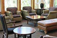 McKinley Chalet lobby (karma (Karen)) Tags: mckinleypark alaska mckinleychalet inns hotel lobby chairs tables benches windows lamps