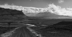 the joy of returning to the Sea (lunaryuna) Tags: iceland westiceland landscape road ontheroad travel journey voyage driving barreninland river coastline mountains sky clouds cloudscape weathermood snaefellsnes leavingthewestfjords roundtrip panoramicviews lunaryuna blackwhite bw monochrome