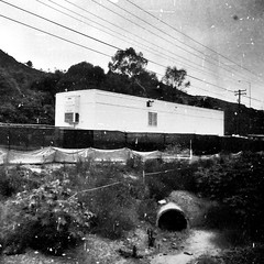 Just a pipe dream away  from L.A (Dom Guillochon) Tags: time life sandiegotolosangeles people living dwelling moving trailer pipe electriclines hills existence reality dream surfliner train ride travelling noiretblanc