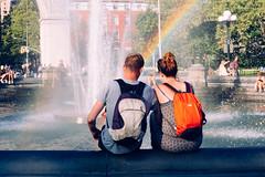 Rainbow Head (L. A. Nolan) Tags: 35mm 35mmf2 50mmequiv backpack fuji fujifilm fujifilmfujinonxf35mmf2 fujifilmxpro2 fujinon man manhattan newyork newyorkcity newyorknewyork ny nyc park people rainbow streetphotography thebigapple washingtonsquarepark waterfountain woman xpro2