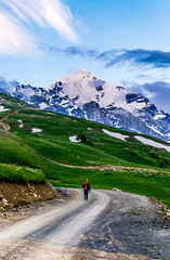 Man on a mountain road (oleksandr.mazur) Tags: above alpine altitude caucasus cliff cloud cloudscape crag dirt dusk evening fluffy freedom georgia glacier high hill ice icecap landscape light man mountain nature outdoor peaceful peak people range relax ridge road rock scenic sky slope snow snowy summer summit sun sunlight sunny sunset sunshine top tourism travel vacation view wall wide