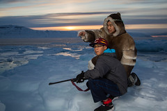 Pilimmaksarniq (Clare Kines Photography) Tags: arctic portrait arcticbay levitation caribouclothing paulcbuffeinstein adamssound nunavut rifle north sunset kanetaqtu multiyearice canada family travis traditionalclothes ice