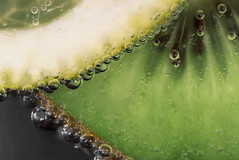Another fruit in the water (Pascal vd Wassenberg) Tags: quiet wide white water wet extreme extensiontubes extrememacro reflection texture tripod tamron yellow dynamic underwater inside indoor iron nice view distanse field filter air light simplicity organic organicpattern photography plant awsome art abstract atmosphere sony serene dof depthoffield fotografie flower fruit good green holland kiwi lemon little closeup nature netherlands natuur nederland natuurmonumenten noordbrabant ngc monopod macro 90mm bells bubble