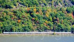 Metro-North Train on the Hudson River, Hudson Highlands, New York (jag9889) Tags: autumn usa ny newyork fall colors train river landscape unitedstates unitedstatesofamerica 2006 foliage hudsonriver waterway westchestercounty cortlandt northriver y2006 20061013 jag9889