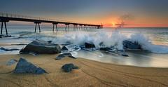 (Jona Mago) Tags: sea espaa water puente pier mar spain agua rocks catalonia amanecer catalua rocas badalona nikon1224mmf4 pontdelpetroli hitechfilters nikond7100