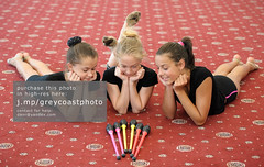 Three girls on the floor looking at Indian clubs (creativemarket.photo) Tags: people girl smile look sport horizontal female train happy person kid child floor exercise watch group young teen gymnast gymnastics lie teenager curious cheerful athlete gym interest sportsman sporty   sportive sportswoman  indianclub