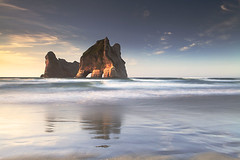 Wharariki Beach (angus clyne) Tags: beach cape farewell south island new zealand sea coast surf swell sand wave wind wild rock stack tunnel sunset blue sky white cloud cave tasmin nelson wharariki