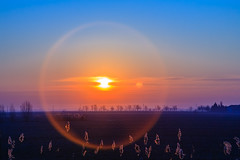 The sun and the moon, together at last (Raoul Pop) Tags: travel winter sunset sky italy moon clouds europe italia seasons flat horizon places it lensflare somewhere ontheroad emiliaromagna
