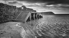 Landing Stage Mono (K_D_B (One Eye On The Sky)) Tags: sea bw water wall canon mono blackwhite wooden sand steps estuary newport ripples slate landingstage kdb parrog dinashd 7dmkii sigma1770f28dcosmacro