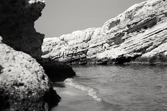 rocks (SS) Tags: ss pentax k5 sand sea smcpentaxm50mmf17 summer water shore seashore holiday beach vacation vieste gargano puglia italy outdoor depth field monochrome blackandwhite spiaggiadellascialara abstract