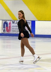 Skater in Black-n-Silver 1 (R.A. Killmer) Tags: skill smile skate skater ice beauty performer performance blades fast glide spin jump form pretty precision