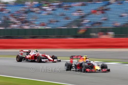 Kimi Raikkonen in his Ferrari catches a Red Bull in Free Practice 2 during the 2016 British Grand Prix