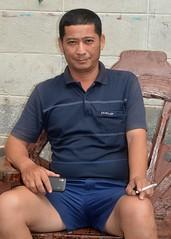 handsome man (the foreign photographer - ) Tags: man portraits thailand wooden chair nikon phone bangkok cigarette cell handsome bang seated bua khlong bangkhen d3200