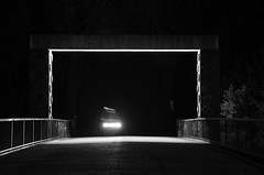 Distorted (HenryBPhotography) Tags: nikon d5100 tamron 18200mm distorted black white long exposure sihouette torn apart light bridge kleinmachnow germany bicycle rider enter void