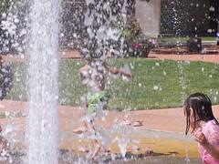 Dancing in Water (suezharris) Tags: kids children playing water sprinkler dancing summer