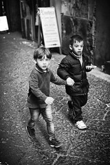 Never Let Him Go (Steve Lundqvist) Tags: monochrome bw brothers bros kids child children scugnizzi street gomorra camorra naples napoli quartieri spagnoli fratellanza fratelli