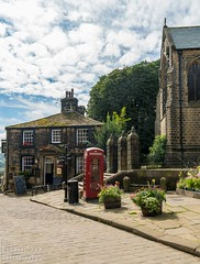 Haworth 1 (chromaphoto.co.uk) Tags: haworth westyorkshire yorkshire bronte wuthering heights main street colour telephone box red pub church