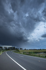 Storm clouds over Luddenham (Sir Mashington the 27th) Tags: road storm rain weather clouds rural day afternoon bend country australia stormy nsw newsouthwales curve luddenham dayafternoon rainruralaustralianewsouthwales