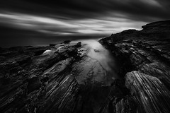 Coastline II (ilias varelas) Tags: longexposure light sea sky blackandwhite bw seascape black water monochrome weather clouds canon landscape mono rocks mood greece ilias canonef1740mmf4l varelas canoneos6d