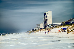 Beach in Florida, (Marianne Venegoni) Tags: ocean vacation people beach buildings walking sand gulf florida condos mionlta
