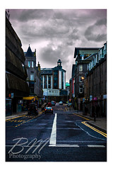 Aberdeen (Bethany Mowat) Tags: road street uk travel pink blue windows winter red two sky people urban cloud sun white cold building bus cars college car sign yellow architecture clouds photoshop work buildings john way walking square landscape outside photography one scotland student day photographer seasons purple post path walk side parking bricks union creative january lewis stormy course marks busy stop aberdeen unknown shops environment portfolio roadside today watermark clack 2015