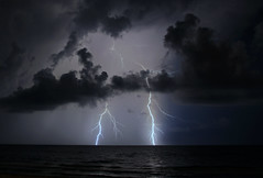 Cool Clouds with Lightning (lightonthewater) Tags: ocean storm reflection gulfofmexico florida thunderstorm lightning seagrovebeach lightonthewater floridathunderstorm