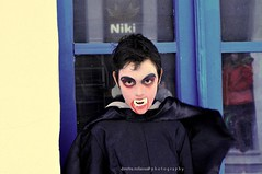 no fear (dimitra_milaiou) Tags: life door blue black glass girl face reflections greek photography costume kid nice eyes nikon europe child d live fear hellas greece carnaval alive 90 niki andros doy dimitra 2015 d90     milaiou