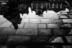 the line between (ewitsoe) Tags: street city sunset urban blackandwhite sun pool monochrome silhouette 35mm buildings puddle scary shadows sundown creepy faded fanboy stephenking relfection nikond80 lovehorror ewitsoe staryryenk feellikeafilmnow
