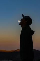 A Mouth Full (charlestheneedler) Tags: aaron borregosprings cc charles chuey earvin josie julian kqranch logan metalsculpture moonrise sunset vanessa
