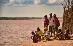Waiting for the Boat (Rod Waddington) Tags: africa african afrika afrique madagascar malagasy manambolo river water tropical passengers waiting group people