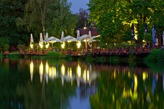 Cafe on the Lake (Eric Luesink) Tags: reflection lake water cafe h2o light long exposure wood dock evening moonrise sunset trees tents bugs outdoors outside dinner sky planters pots plants greenery shrubs birch oak