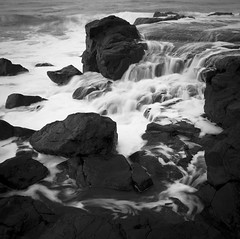 Black Rock ocean waterfalls (Trace Connolly) Tags: australia environment environmentalphotography rocks blackrock ocean sea bellarinepeninsula surfcoast waterfall waterfalls seascape landscape victoria black white photography bw blackandwhitephotography flickr outdoor outside contrast water