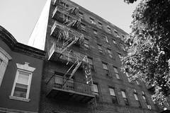 NYC (oscarheaneybrufal) Tags: white black bw america metro leffertsavenue brooklyn newyork fireescape buildings