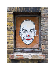 Street Art (Unknown), East London. England. (Joseph O'Malley64) Tags: streetart graffiti eastlondon eastend london england uk britain british greatbritain pasteup wheatpaste mixedmedia paper blockedwindow plywood board panel windowframe steelbar bricklintel brickwork pointing windowledge