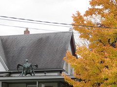 Gargoyle Guy In Middlesex (amyboemig) Tags: october middlesex vt vermont 251 statue sculpture yard porch maple tree foliage