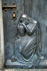 Sorrow - Metal embossing on a tomb door (VinayakH) Tags: tombs tomb recoletacemetery recoleta larecoletacemetery cemetery buenosaires graves argentina latinamerica southamerica mausoleum artnouveau artdeco neogothic baroque architecture