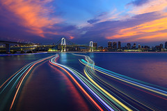 Sunset with Light Trails 5962 (kbaranowski) Tags: 2016krzysztofbaranowski krzysztofbaranowski nihon nippon japan japaneseculture tokyo tokio capitalcities touristattraction famousplace touristdestination buildingexterior urban urbanlandscape urbanstreets citylife cityscape skyline skyscraper tranquility architecture modern elevatedview nopeople illuminated night photography horizontal panoramic longexposure lighttrail twillight ontheway transportation outdoors dusk sunset reflection bridge rainbowbridge ship