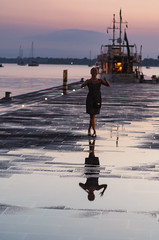 woman and sunset (Marco Brunetti) Tags: reflections woman sicily sicilia siracusa syracuse sunset sea pentaxk30