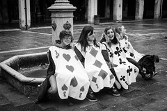 Recess in Wonderland (laskaproject) Tags: city travel carnival venice girls portrait bw italy white black fountain square cards costume group teenagers laughter wonderland recess aliceinwonderland