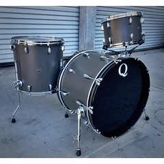 "I love simple, clean looking drum sets. This perfect example is a mahogany set wrapped in a dark flat grey. 22"". 13"", 16"" (10"" and 12"" toms not pictures) #qdrumco #mahogany"