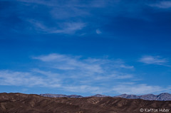 Death Valley - Passing Clouds - 21015 (www.karltonhuberphotography.com) Tags: california sky mountains texture nature beautiful horizontal clouds landscape outdoors happy nationalpark desert exploring details horizon smooth relaxing peaceful bluesky adventure layers deathvalley rolling naturephotography 2014 deathvalleynationalpark mountainpeaks landscapephotography desertscape creativeperspective nikond7000 amaving karltonhuber