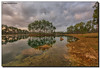 And Then the Rain Came (Fraggle Red) Tags: morning lake reflection rain clouds landscape nationalpark rocks florida evergladesnationalpark campground hdr enp longpinekey 7exp canonef1635mmf28liiusm miamidadeco dphdr canoneos5dmarkiii 5d3 5diii adobelightroom5