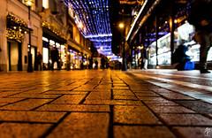 Under the Lights (fearghal breathnach) Tags: christmas dublin blur lights dof bokeh pavement christmaslights graftonstreet