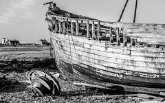 The Other Side of the Seaside (DobingDesign) Tags: wood old blackandwhite abandoned beach rotting boats coast boat seaside industrial sad decay coastal dungeness disused lonely rotten decrepit fishingboat redundant wornout woodworm fallingapart dumped