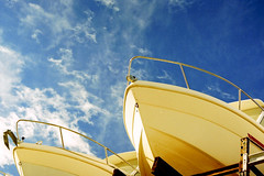 film (La fille renne) Tags: blue sky film yellow analog 35mm boat xpro slide crossprocessing agfactprecisa100 topconrm300 55mmf17